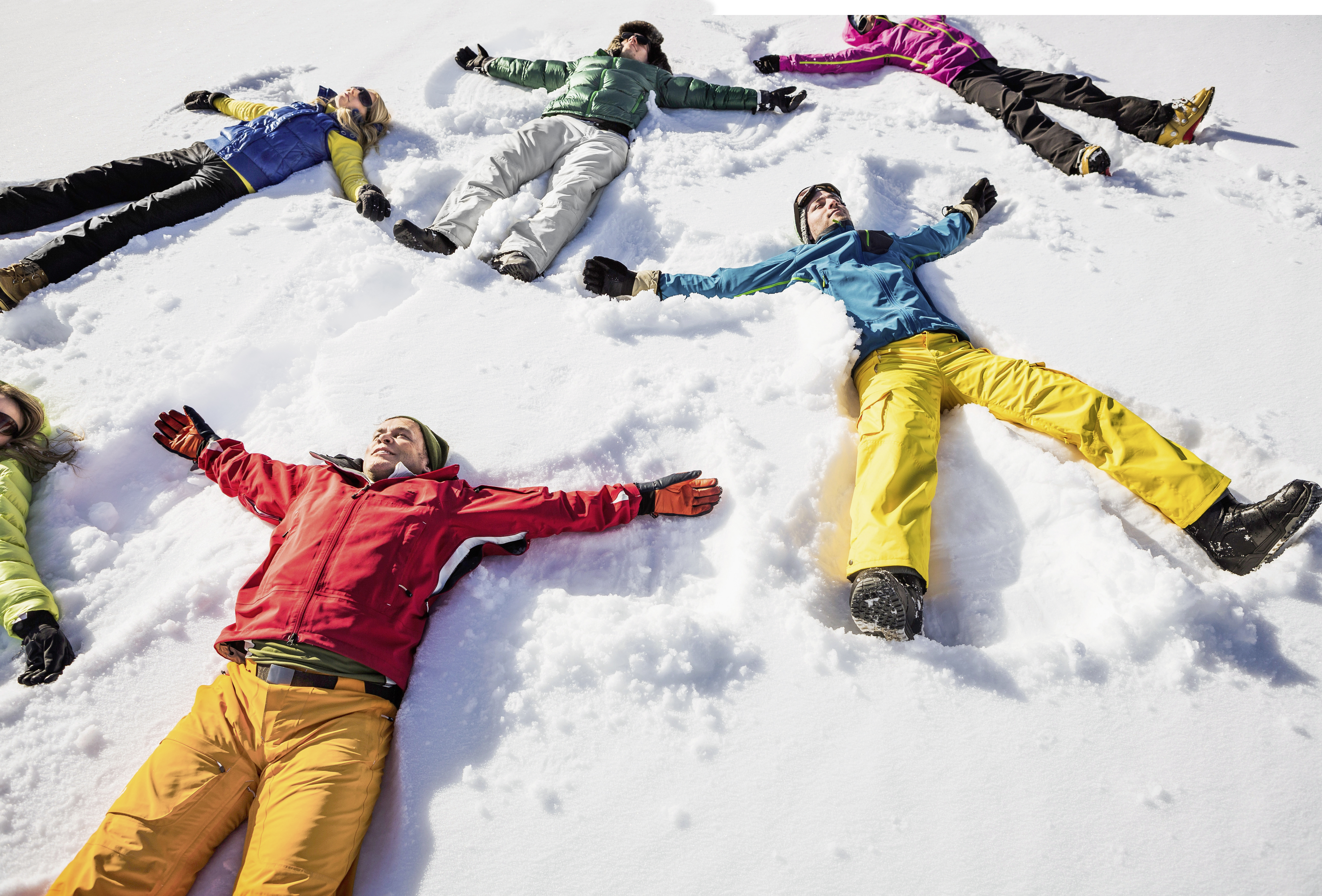 Group of friends doing snow angels